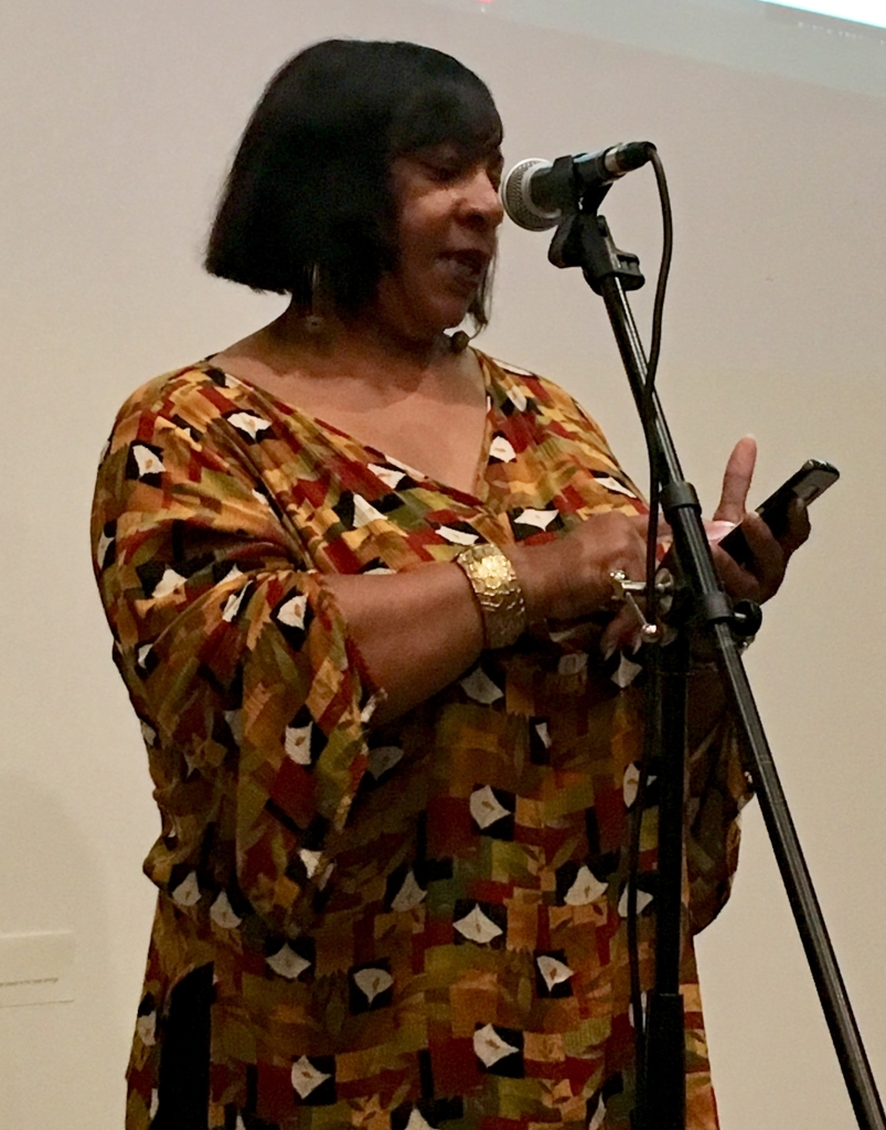 Dera R. Williams, author, writer, Griot reads from her cell phone for Litquake Lit Crawl 2018